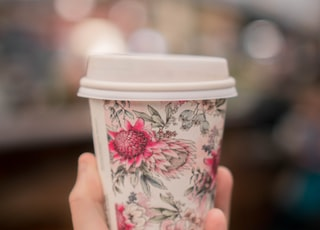 white and pink floral disposable cup