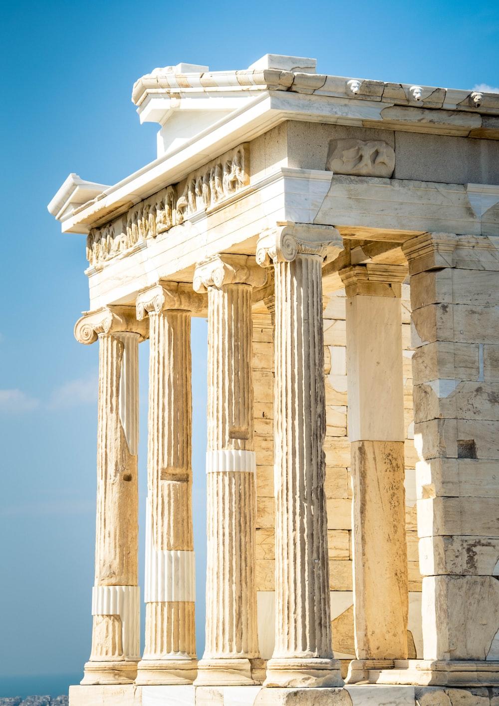 beige concrete pillar under blue sky during daytime