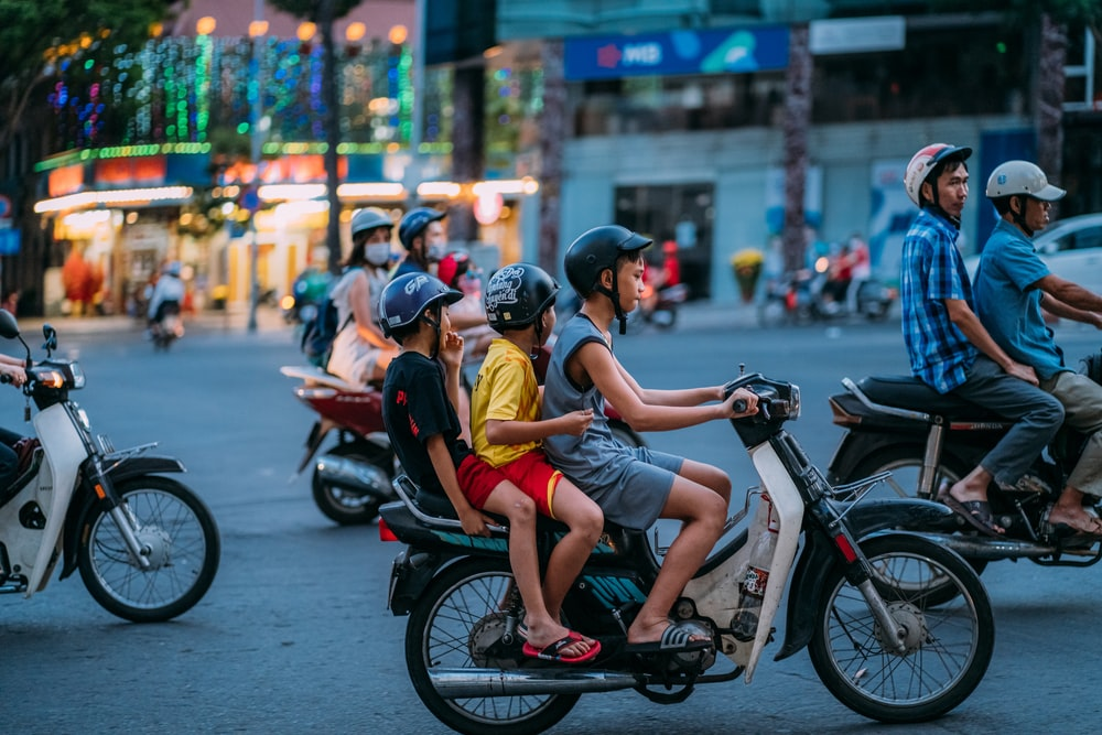 man in yellow shirt riding motorcycle with woman in yellow shirt