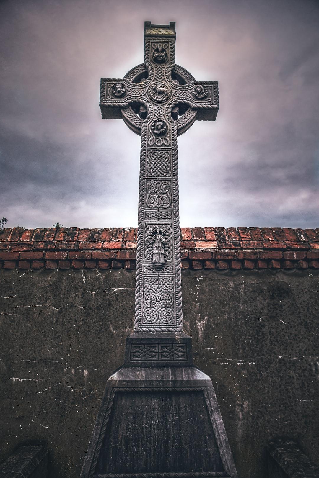 An ornate Celtic cross in the graveyard on the grounds of St. Nicholas' Church of Ireland Parish in Carrickfergus, County Antrim (Jan., 2020).
