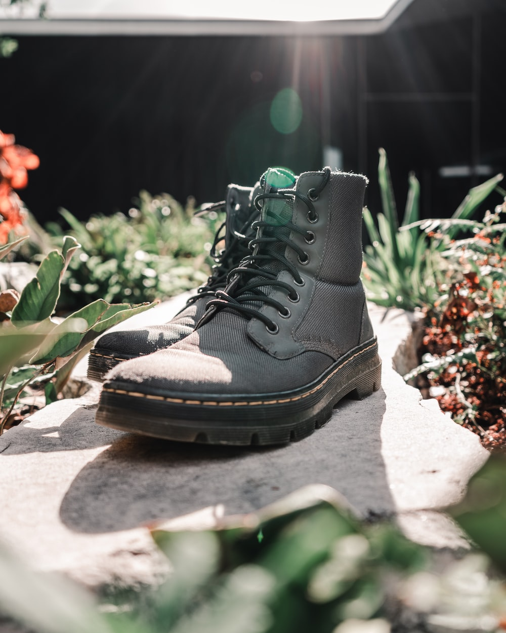 black and brown hiking boot on white textile