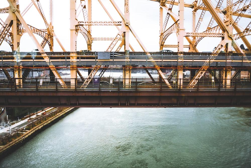 brown metal bridge over blue sea during daytime