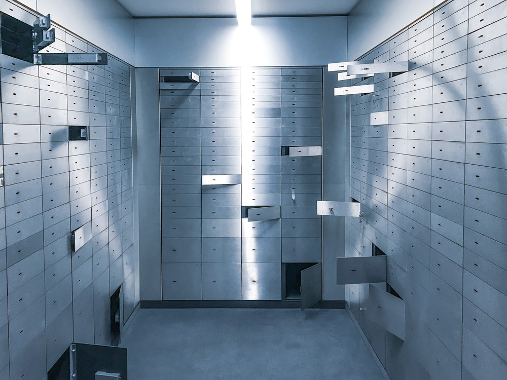 white and gray metal locker