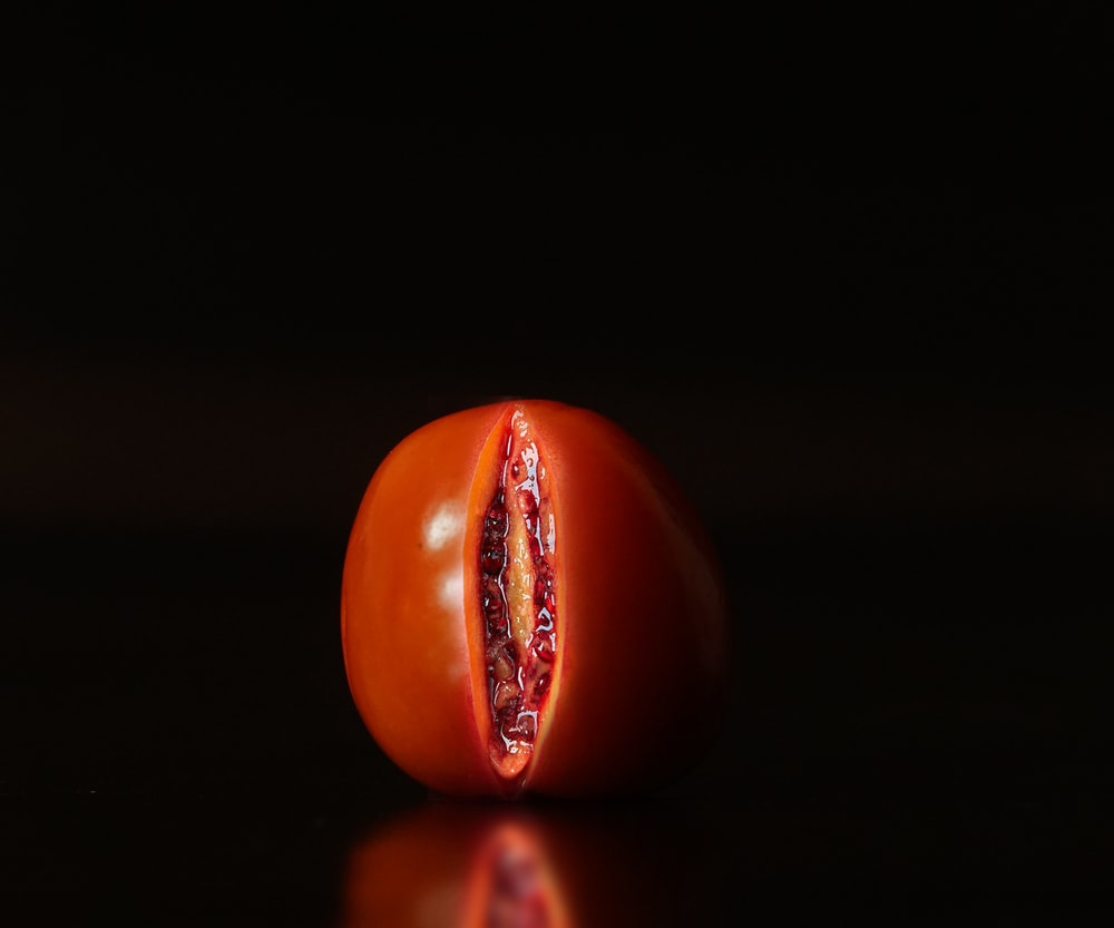 red tomato on black surface