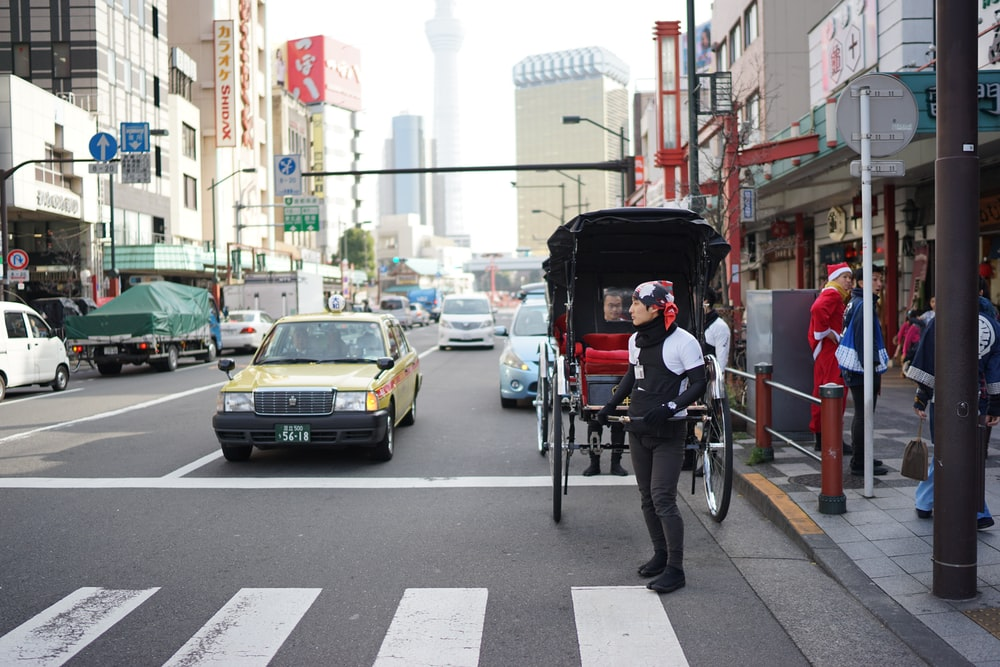 people riding on bicycle on road during daytime
