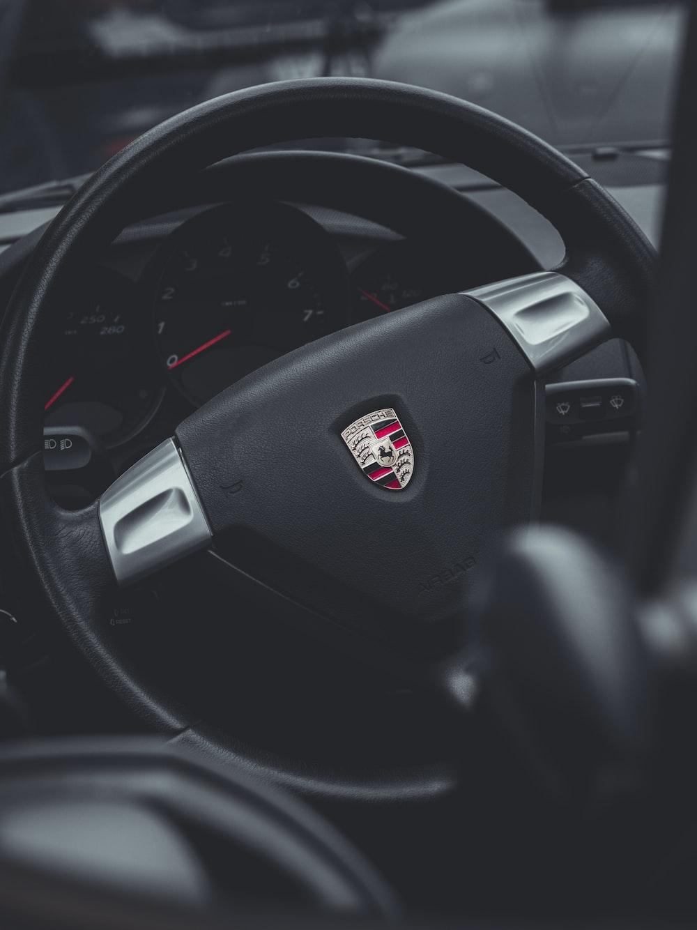 black porsche car steering wheel