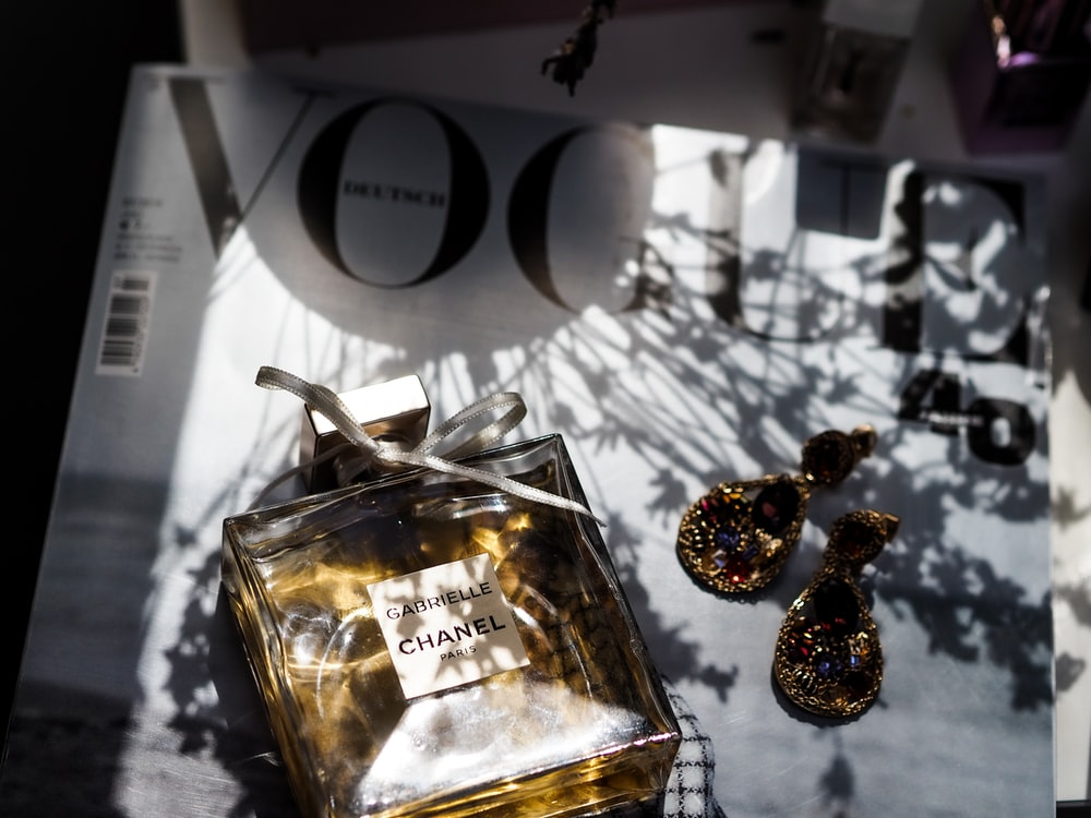 gold and silver baubles on clear glass bottle