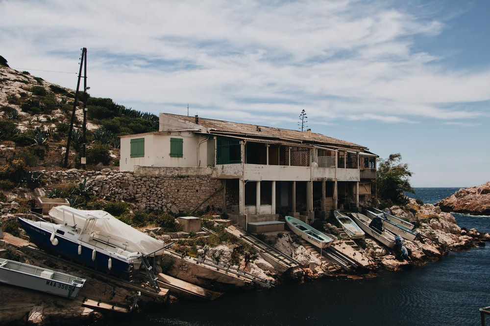 white and brown concrete building near body of water during daytime