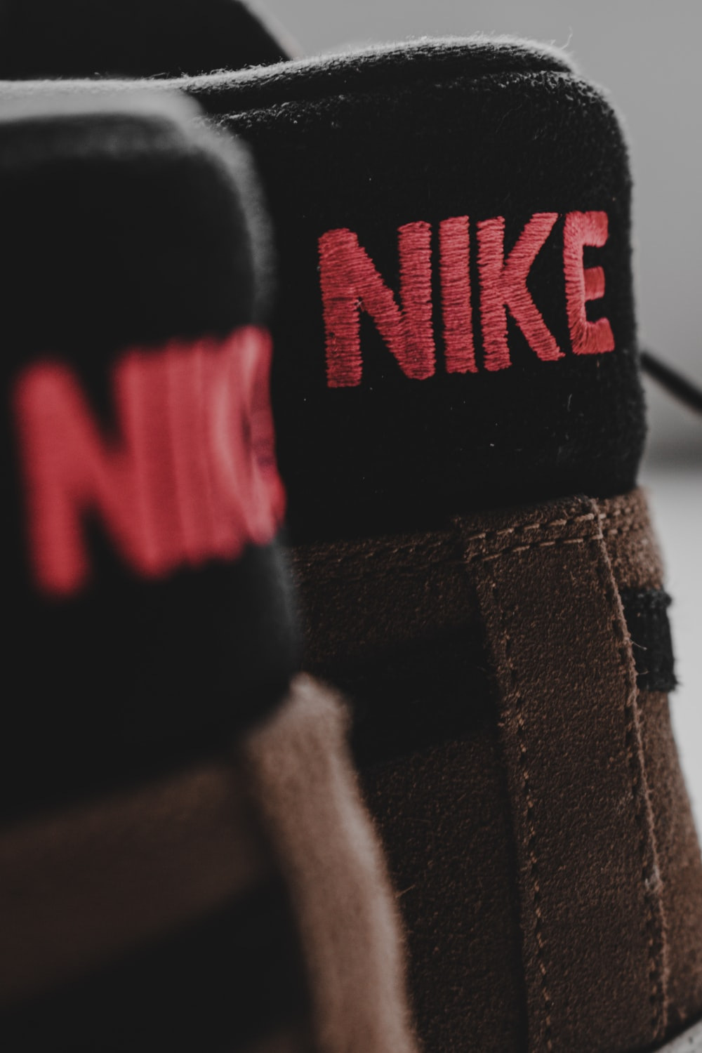 black and red nike shoe