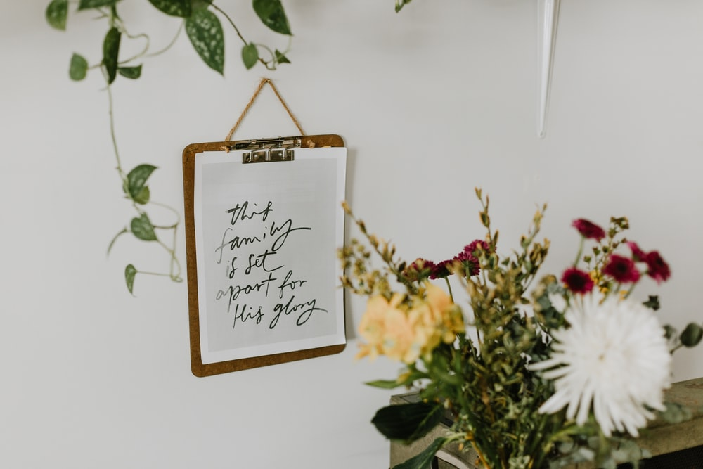 brown wooden frame with white and yellow flowers