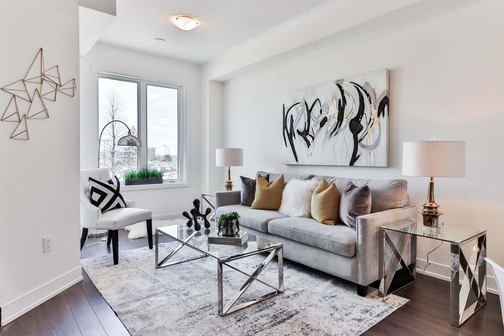 gray sofa near glass table