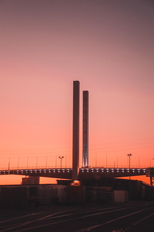silhouette of bridge during sunset