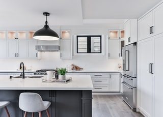 white wooden kitchen cabinet with sink and cabinet