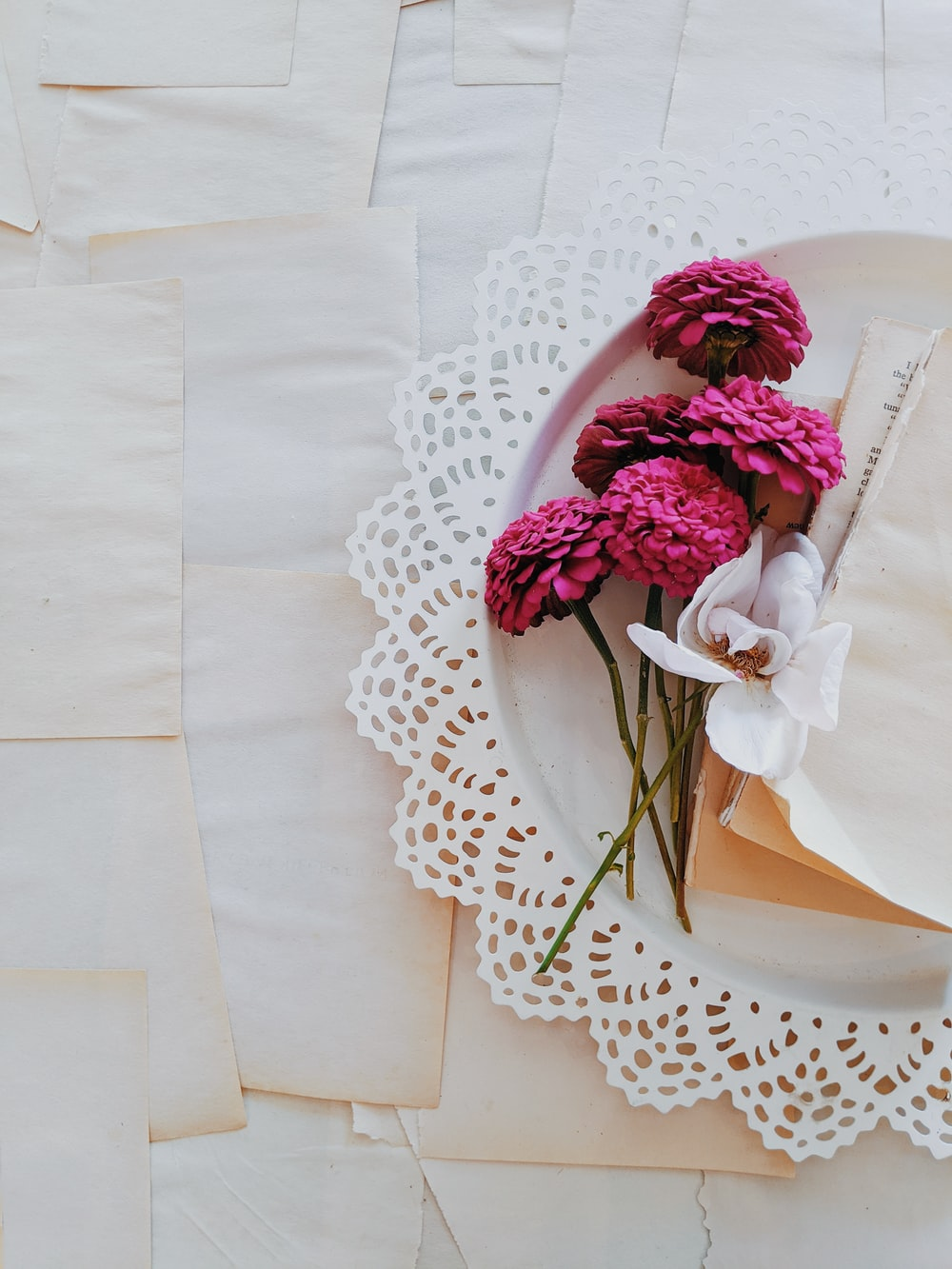 pink and white flower bouquet on white table cloth