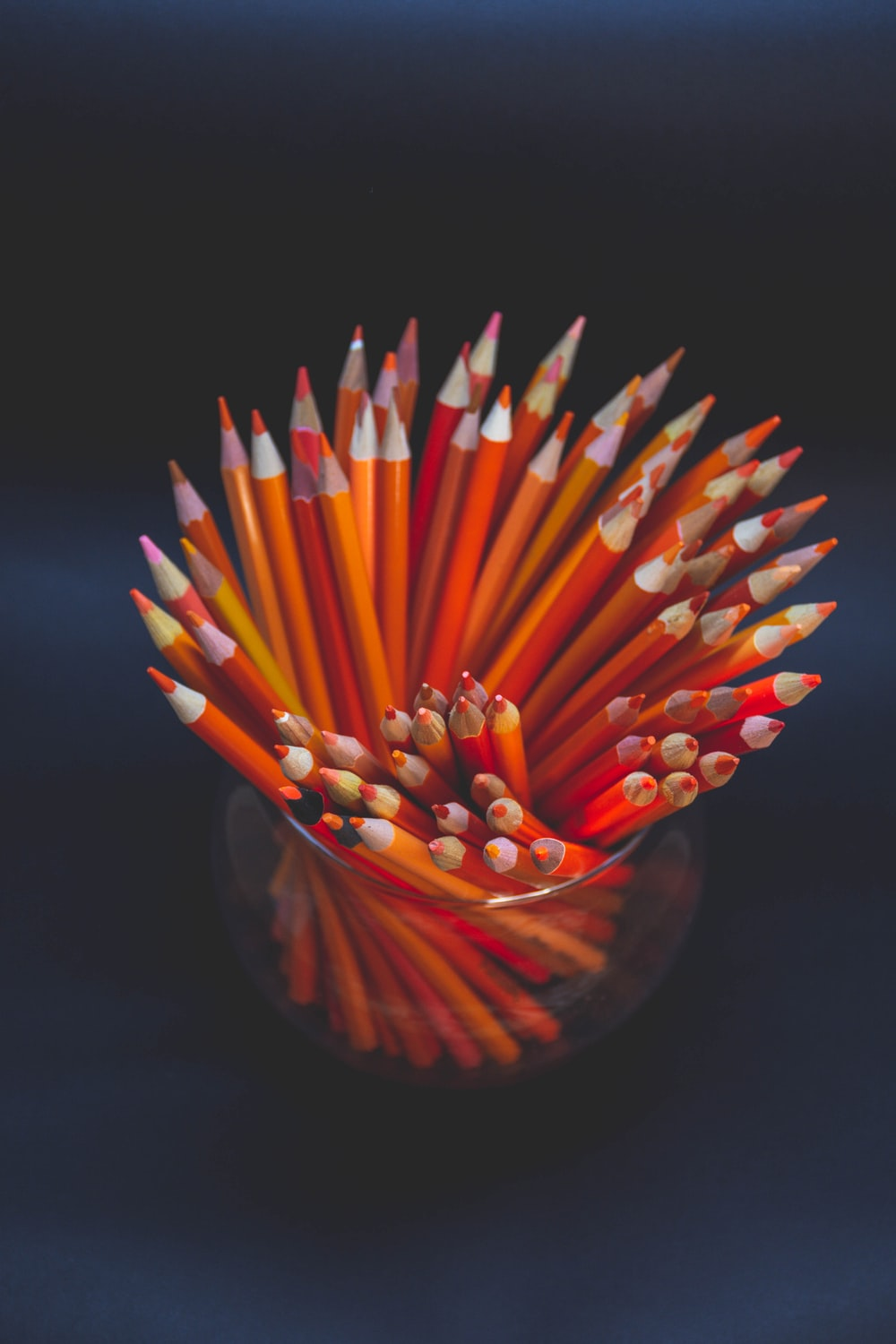 coloring pencils in brown glass container