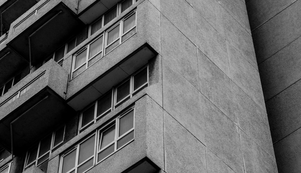 gray concrete building with glass windows