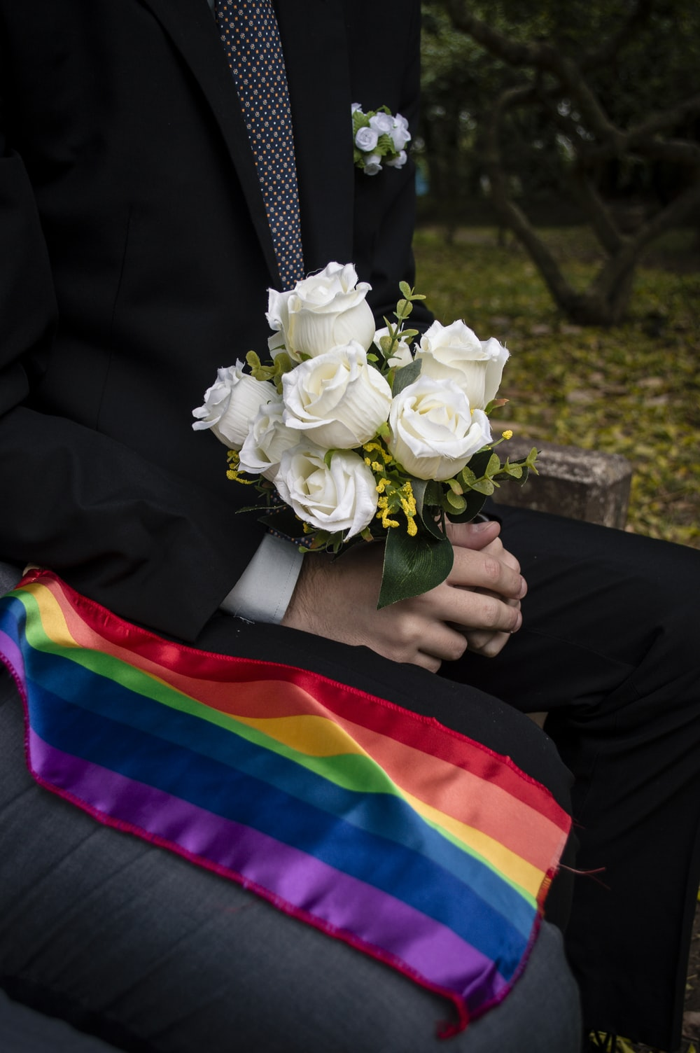 person holding white rose bouquet
