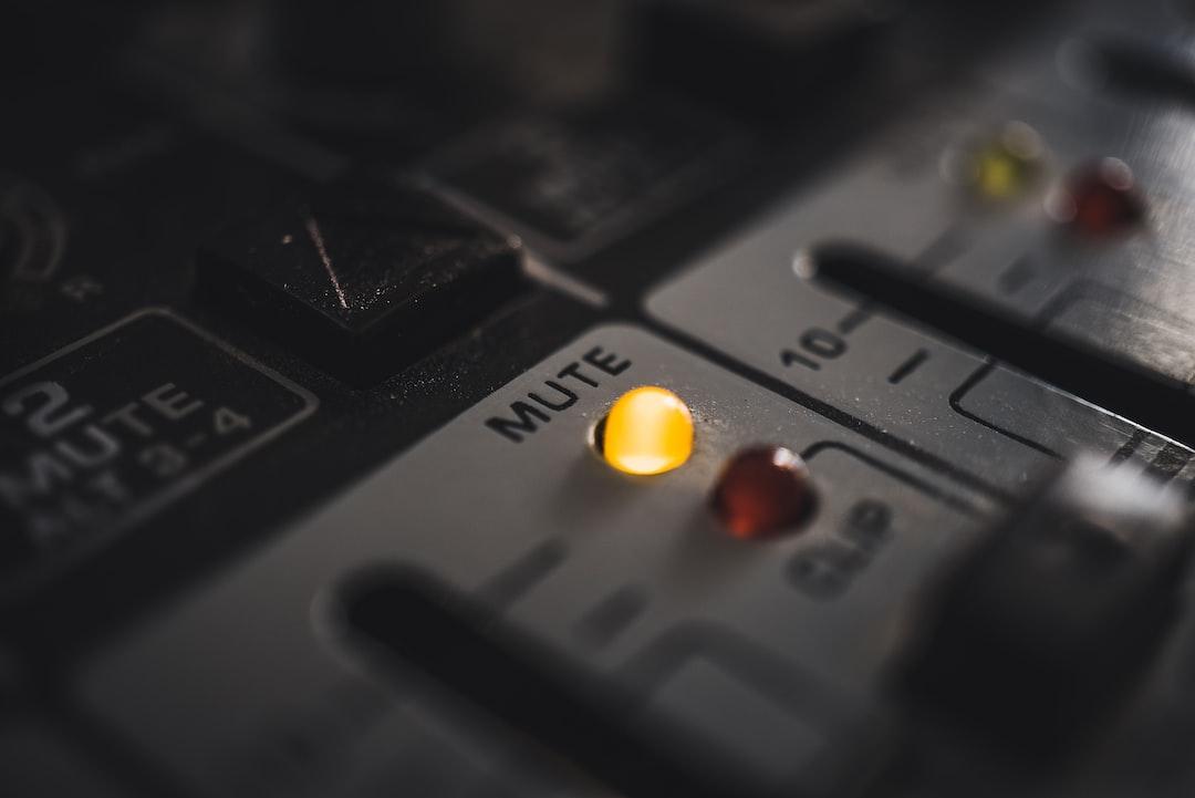 A mute LED on a modern, digital audio mixer.