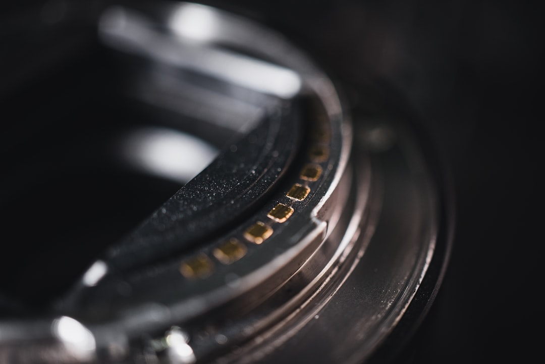 Macro shot of the contacts of a Sony E-Mount electric lens at the bayonet.