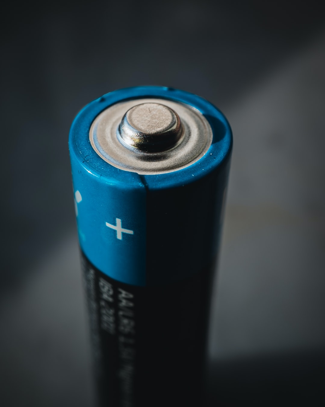 A macro shot of a normal AA type battery cell on the + / Cathode side.