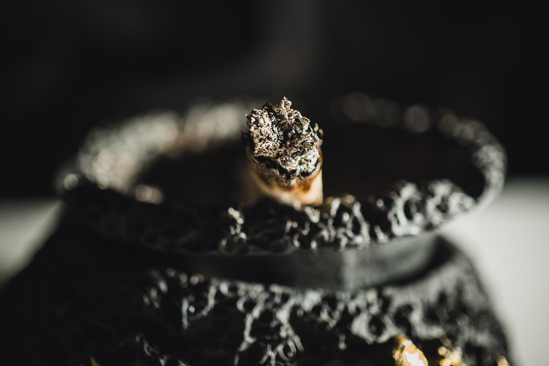A burnt cigarette / joint in an ashtray.