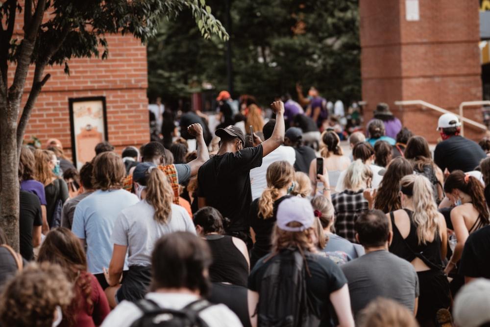 people gathering near brown brick building during daytime