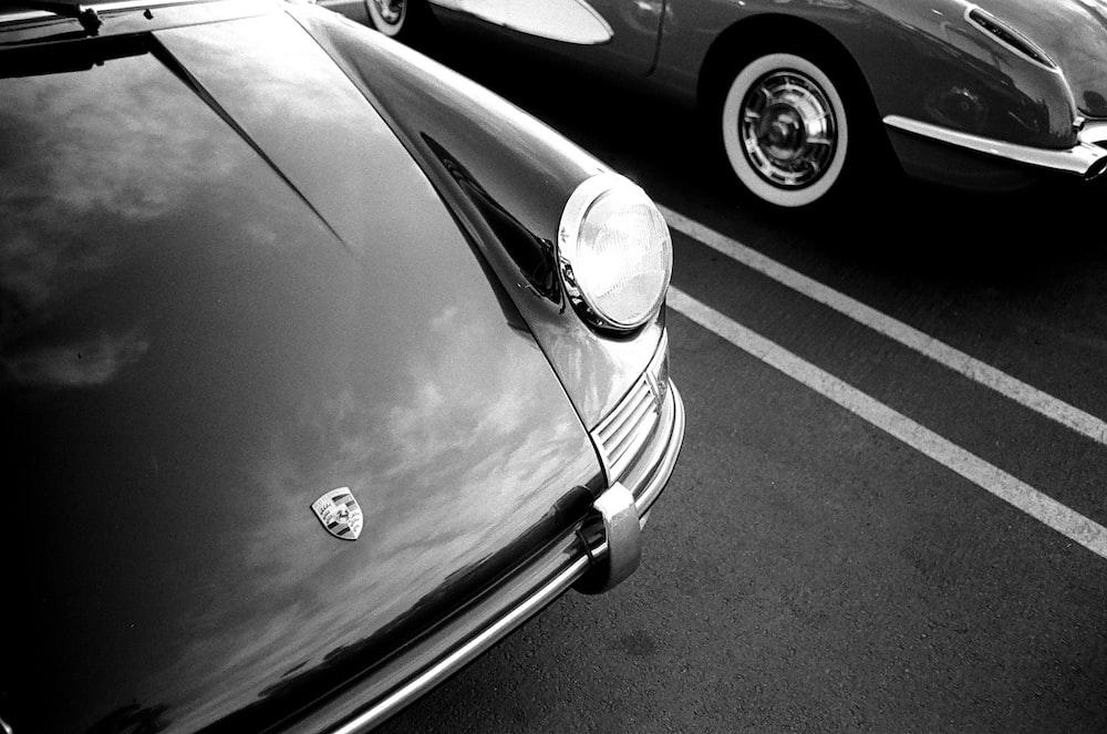 grayscale photo of car headlight