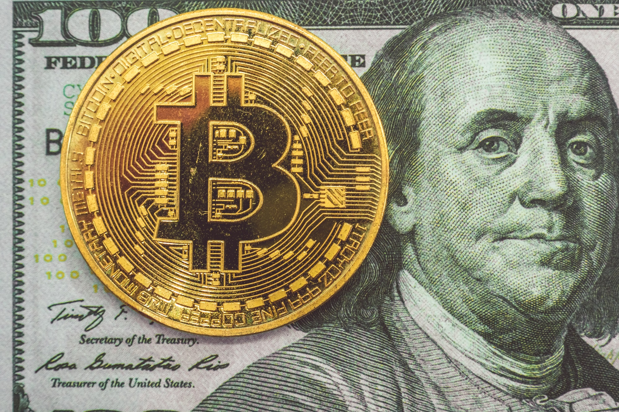 Bitcoin on hundred dollars bills