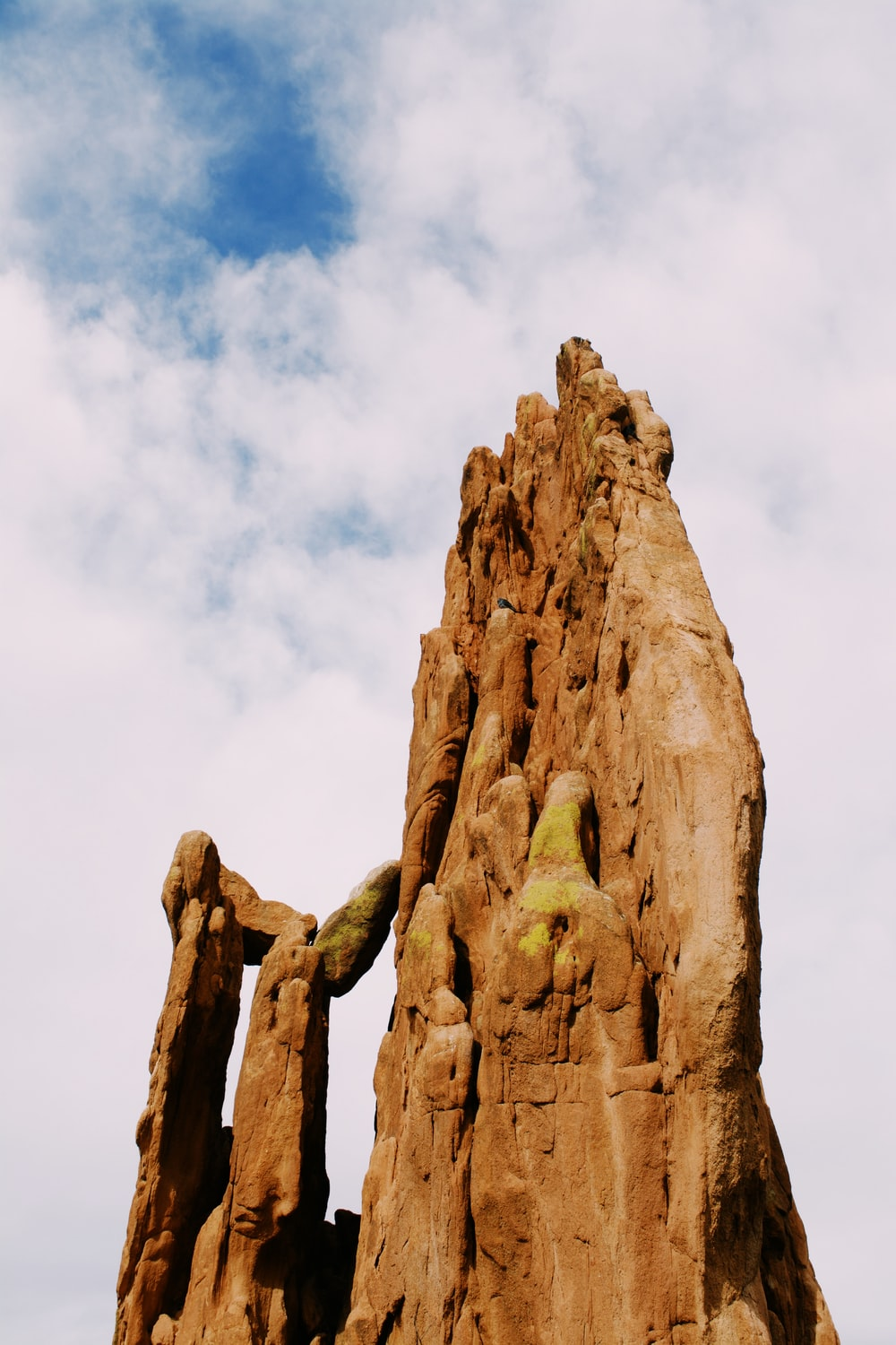 brown rock formation under white clouds during daytime