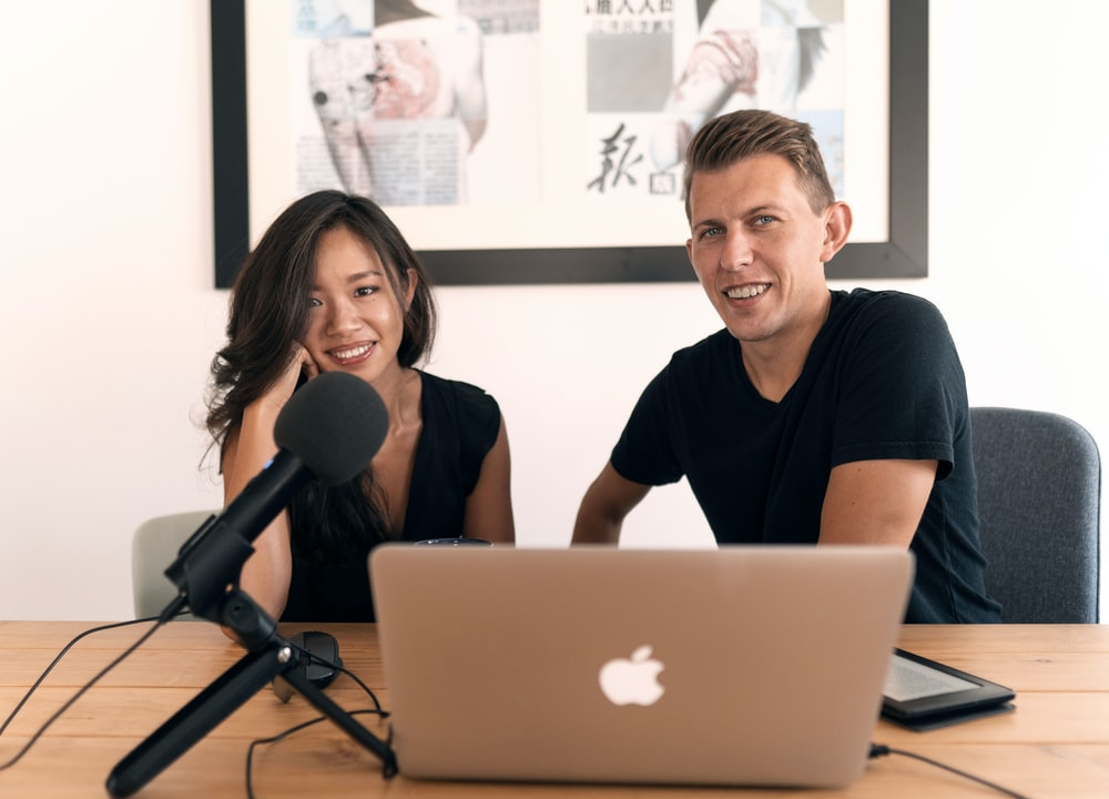 man in black crew neck t-shirt sitting beside woman in black shirt