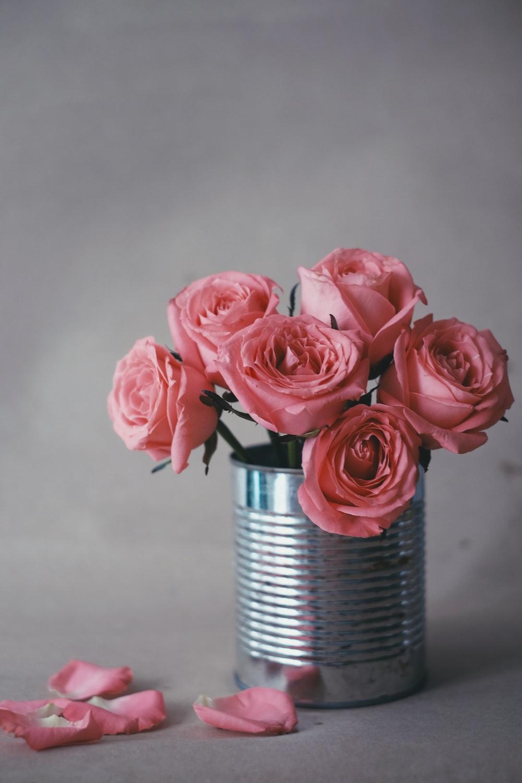 pink roses in gray steel vase