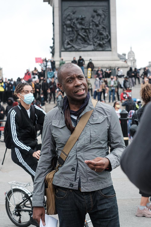 man in gray coat smiling