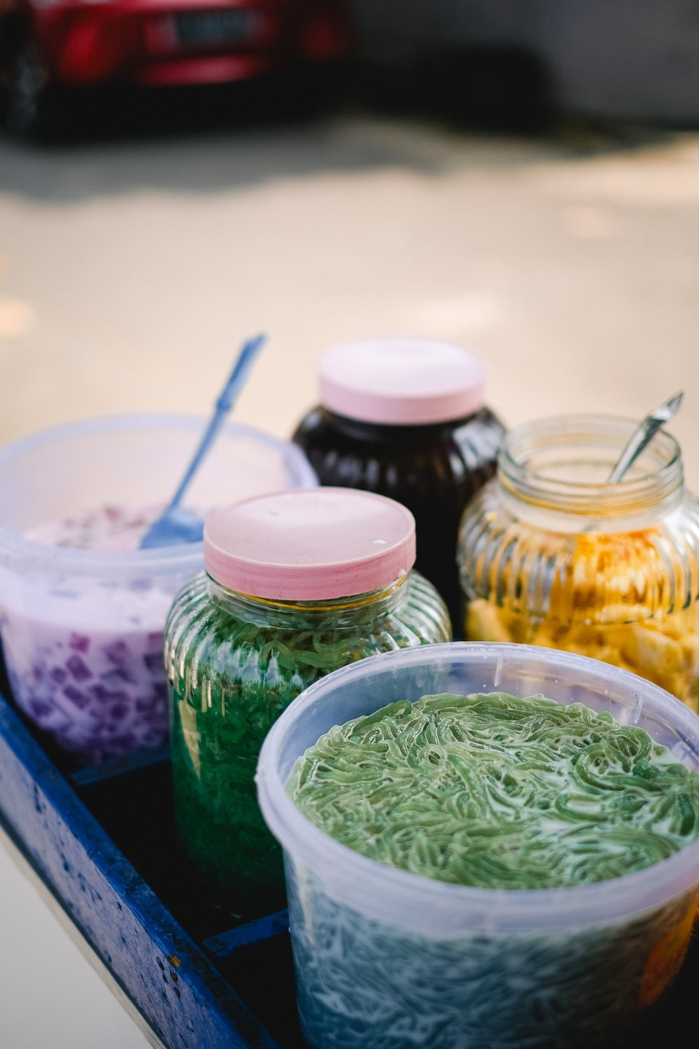 green leaves in clear glass jars