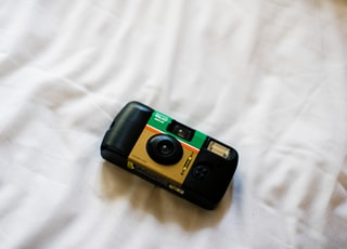 black and green point and shoot camera