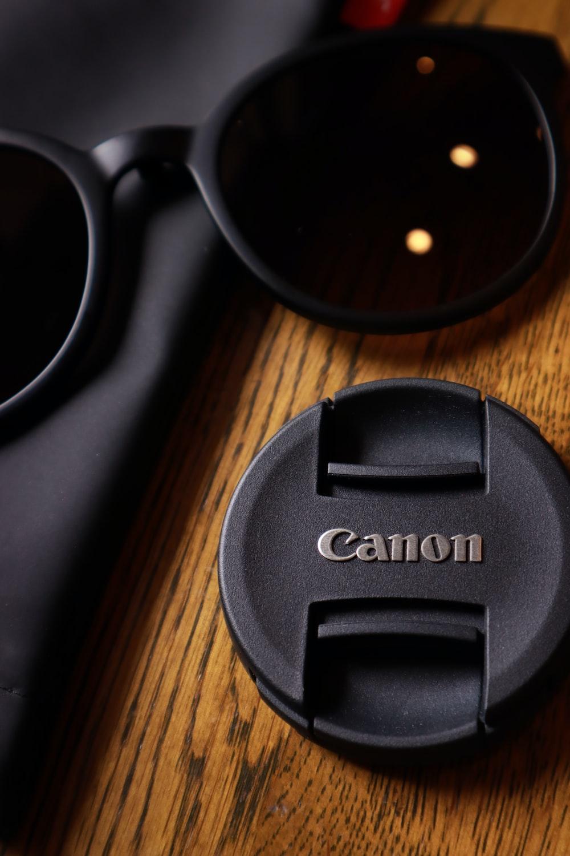 black nikon camera lens cover