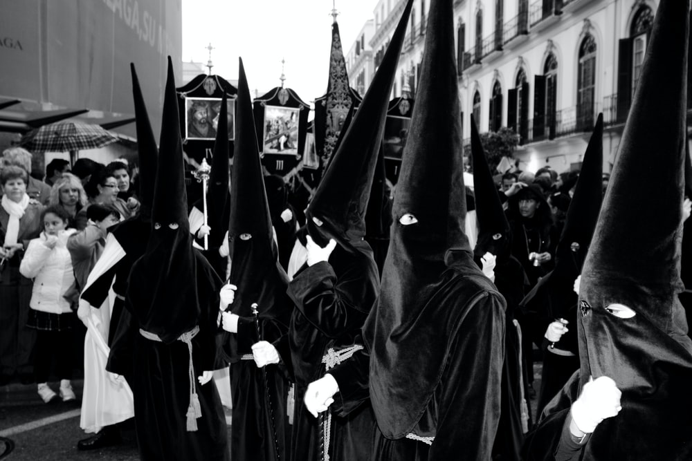 grayscale photo of people in black robe