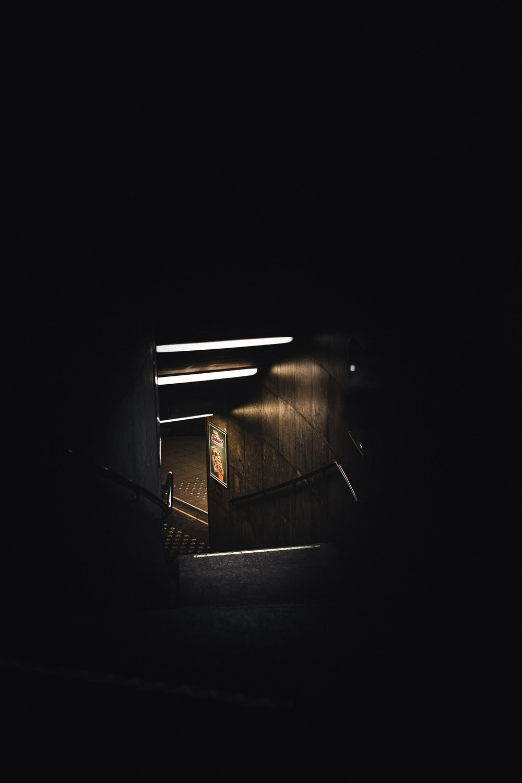 brown wooden stairs in dark room