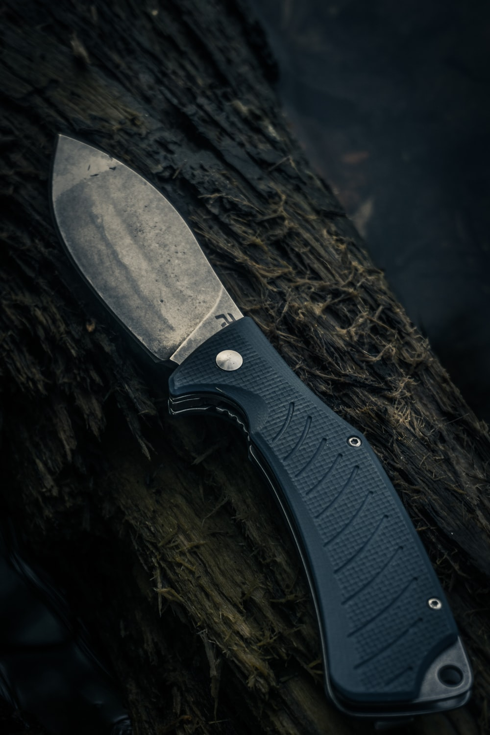 black and silver knife on brown wooden surface