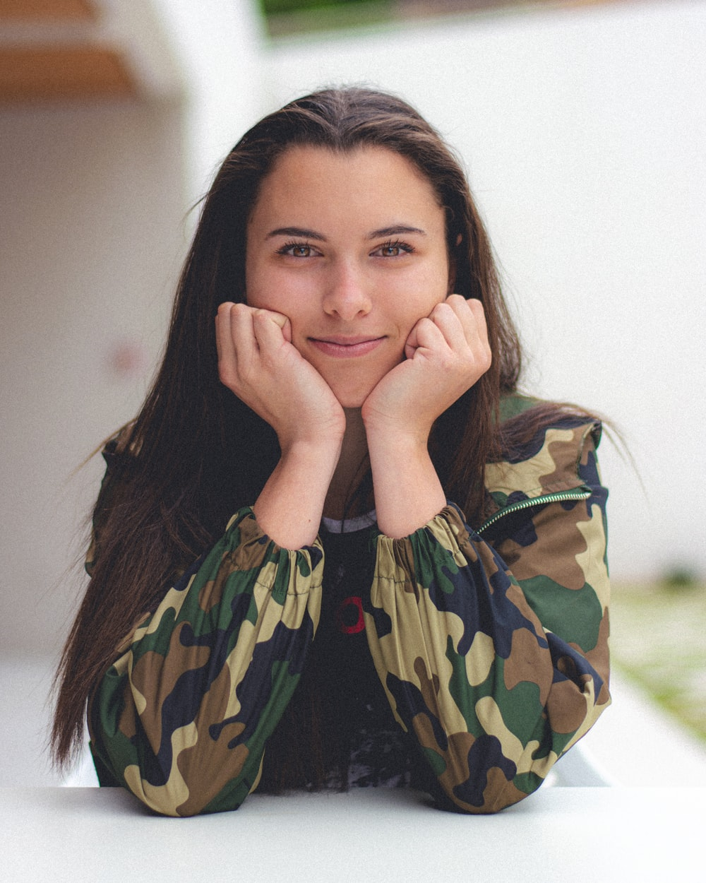woman in green and black camouflage jacket