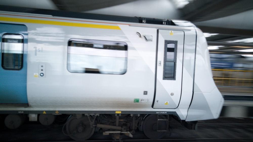 white train on train track