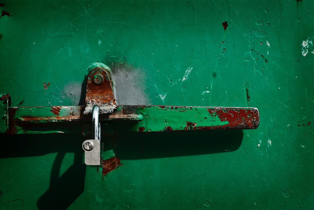 Padlock on green container