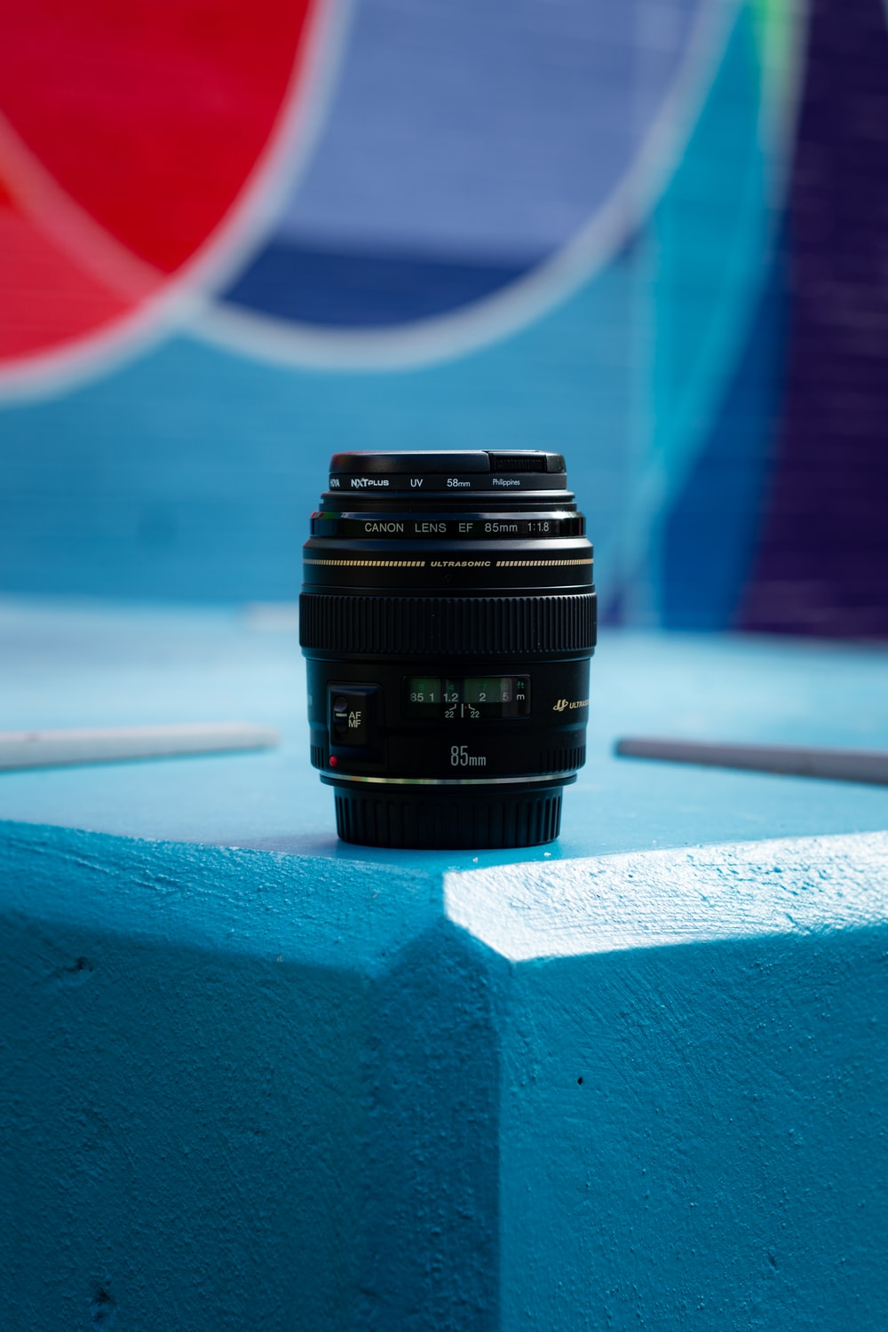 black camera lens on white and blue surface