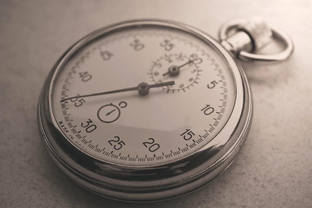 silver pocket watch at 10 00