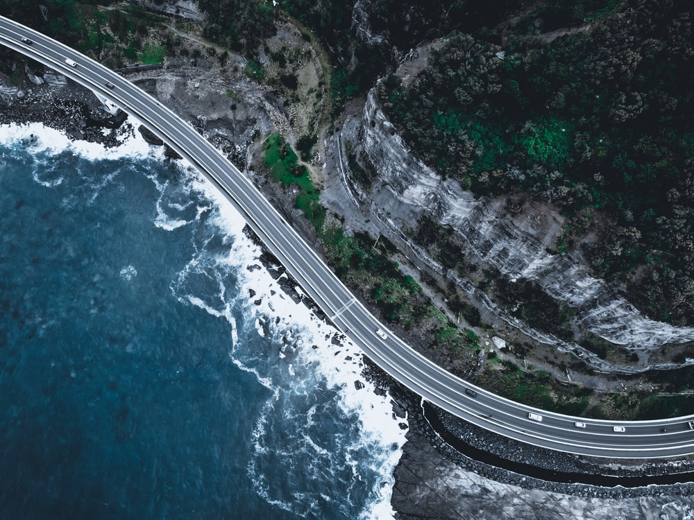 aerial view of a road in the middle of a city