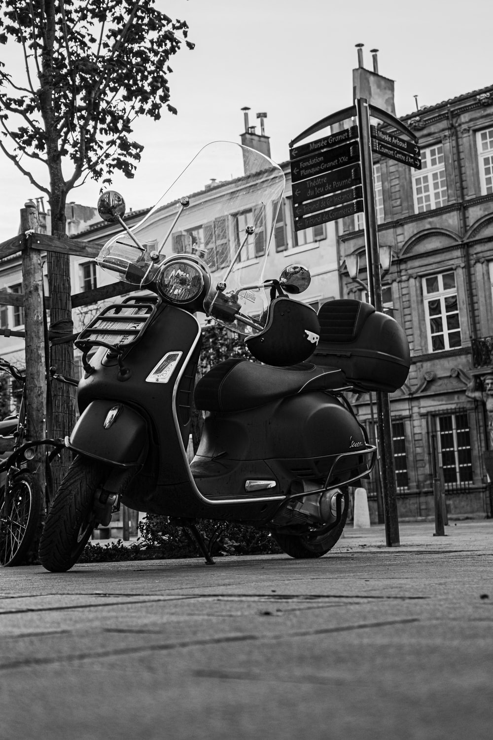 grayscale photo of motorcycle parked on street