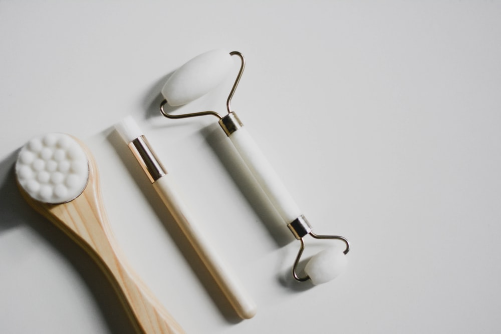 silver spoon and fork on white surface