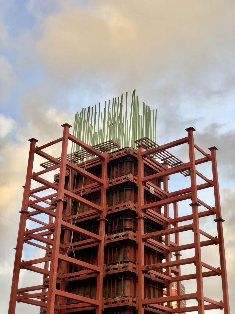 brown wooden tower under cloudy sky