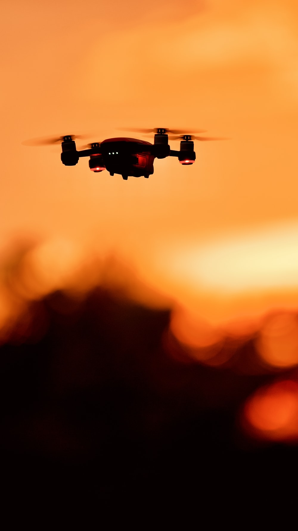 black and orange drone in mid air