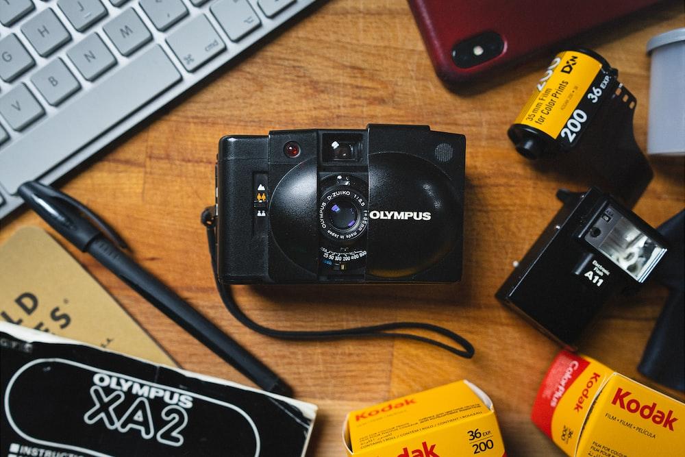 black nikon dslr camera on brown wooden desk