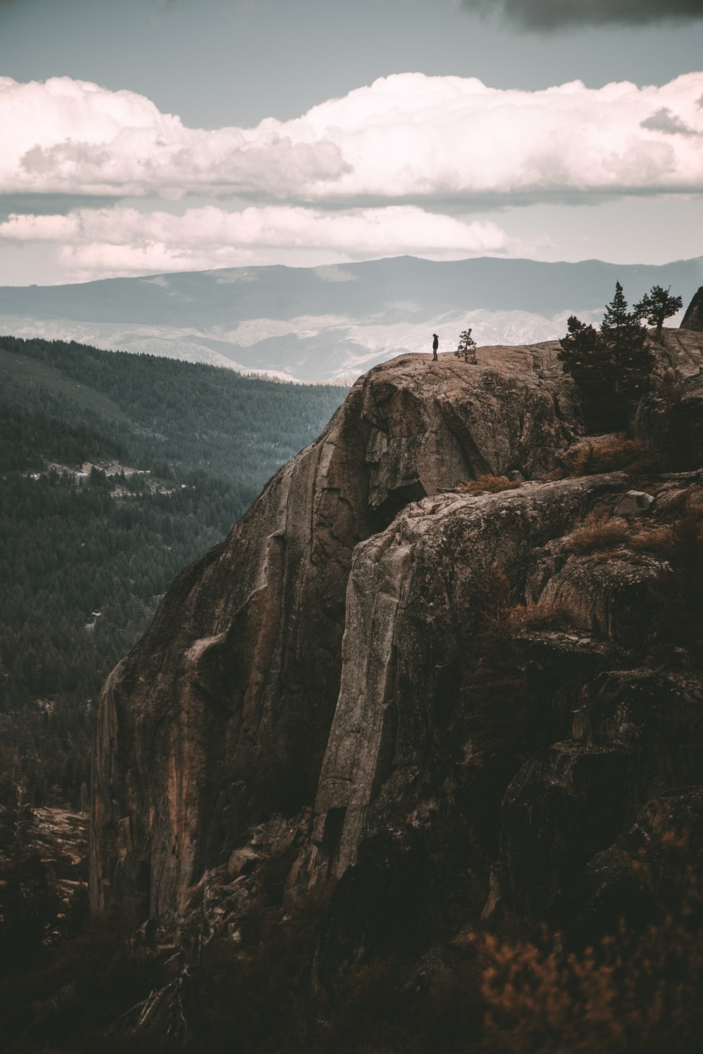 people standing on rock formation during daytime